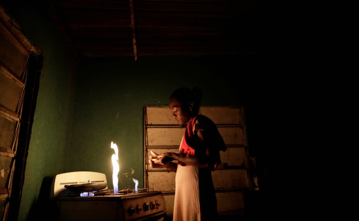Aidalis Guanipa, 25, a kidney disease patient, prepares her breakfast, before a day of dialysis, at her home, during a blackout in La Concepcion, Venezuela, April 29, 2019. Reuters