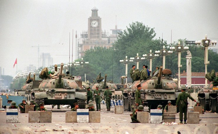This file photo taken on June 6, 1989 shows People's Liberation Army (PLA) tanks and soldiers guarding Chang'an Avenue leading to Tiananmen Square in Beijing, two days after their crackdown on pro-democracy students. AFP
