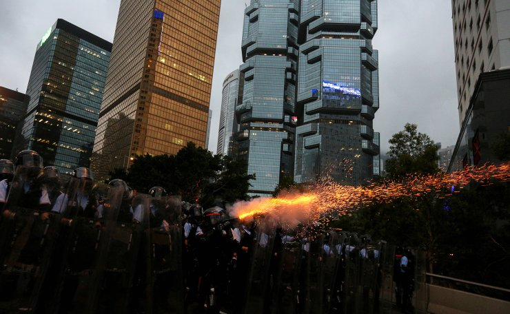 Police officers fire tear gas during a demonstration against a proposed extradition bill in Hong Kong, China June 12, 2019. Reuters