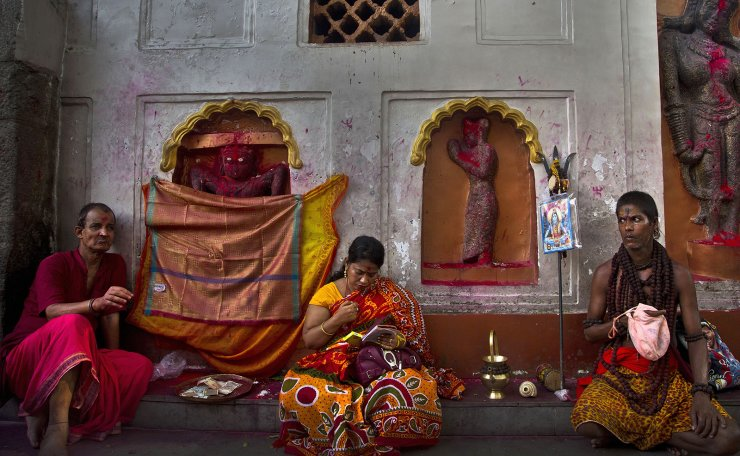 In this June 23, 2019 photo, devotees perform rituals beside idols of goddess Kamakhya during Ambubachi festival at the Kamakhya temple in Gauhati, India. The temple is presided over by the goddess Kamakhya, the most important goddess of tantric worship, an esoteric form of Hinduism. The four-day Ambubachi festival is a celebration of Kamakhya's yearly menstrual cycle, and it brings hundreds of thousands of devotees to the temple. AP