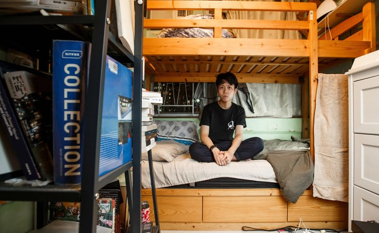 Native Hong Kong resident Sonic Lee, 29, a musician and composer, who lives with his mother, poses for a picture in his 6 sq meter bedroom of his family's apartment in Hong Kong, China June 28, 2019. 'For me, the Umbrella Revolution is like telling a story, it's Marvel [comic]. It's not going to happen in Hong Kong. There are no superheroes. Nothing will happen in one big movement. I don't believe it anymore. If anything will change in Hong Kong it will be many small people doing many small things and you add them together,' Lee said. 'Yes, I'm afraid about books that I cannot read or works we cannot write or songs we cannot sing. At the same time, it makes art and music more powerful. Especially Rock'n Roll music. If I use music to talk about what is happening and what we need to fight for, then music will become important in this city.' Reuters