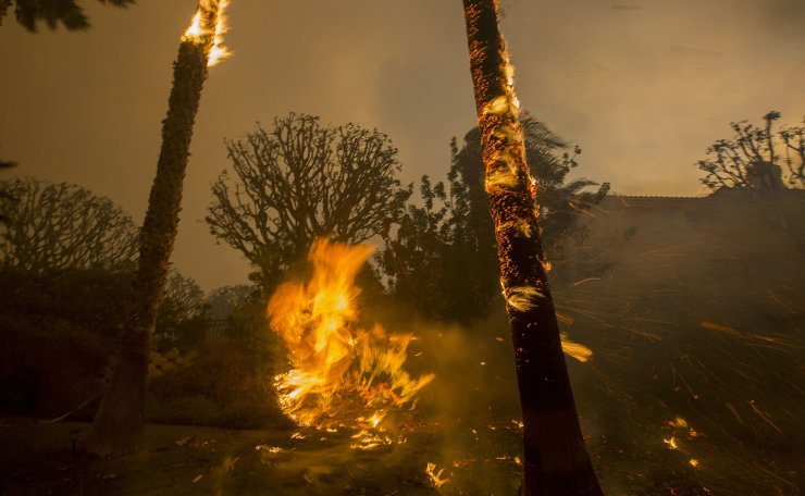 Embers are blown by strong winds roaring sound during the Woolsey Fire on November 9, 2018 in Malibu, California. AFP