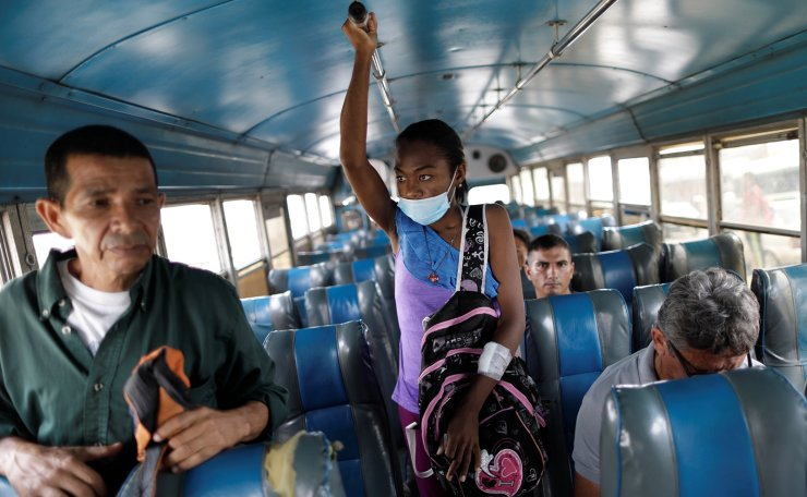 Aidalis Guanipa, 25, a kidney disease patient, travels by bus after a dialysis session at a dialysis centre in Maracaibo, Venezuela, April 26, 2019. Reuters