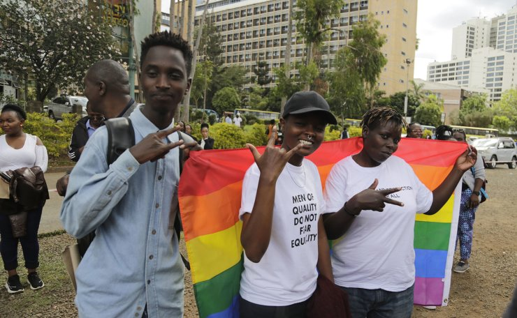 Kenya gay and Lesbian activists and their supporters gather outside the Milimani Court in Nairobi, Kenya Friday, May 24, 2019. Kenya's High Court is due to rule Friday on whether laws that criminalise same sex relations are unconstitutional. AP