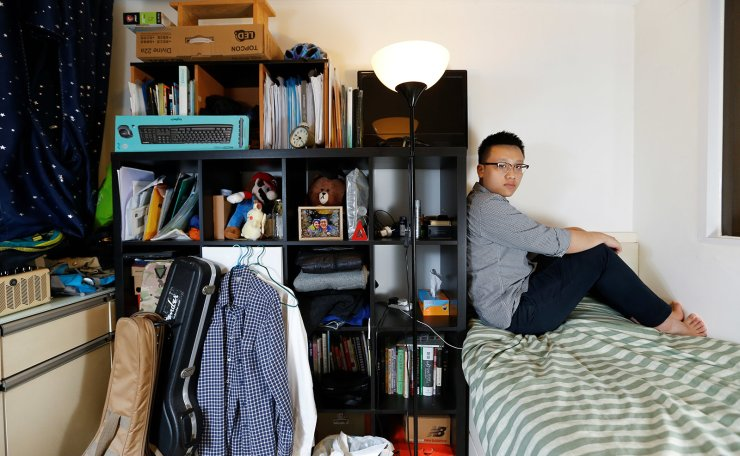 Native Hong Kong resident John Wai, 26, an engineer, who lives with his parents and a sister, poses for a picture in his 7 sq meter bedroom of his family's apartment in Hong Kong, China, June 25, 2019. 'What makes me angry is that the government allows mainland people to buy those very limited resources of land. The property agencies drive the prices so high that we cannot afford them,' Wai said. Two years into his career after graduating from a top Hong Kong university, he feels he doesn't get what he deserves. He puts money aside, pays back his parents and pays his student loan. This doesn't leave him with enough money to get his own apartment. 'I'm really considering emigrating. To Singapore or Thailand. The reason is that I'm disappointed about the future of Hong Kong. I can see the Chinese government further suspending our rights.' Reuters