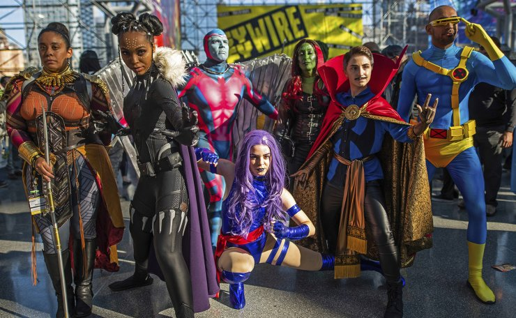 Costumed superheroes pose during New York Comic Con at the Jacob K. Javits Convention Center on Saturday, Oct. 5, 2019, in New York. AP