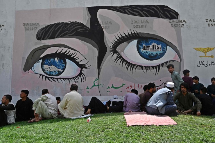 People sit near the French embassy in Kabul on August 18, 2021 following the Taliban stunning takeover of Afghanistan. AFP