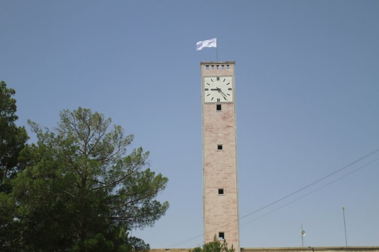 A Taliban flag flies from the clocktower of the Herat provincial official office, in Herat, Afghanistan, west of Kabul, on Saturday, Aug. 14, 2021. AP