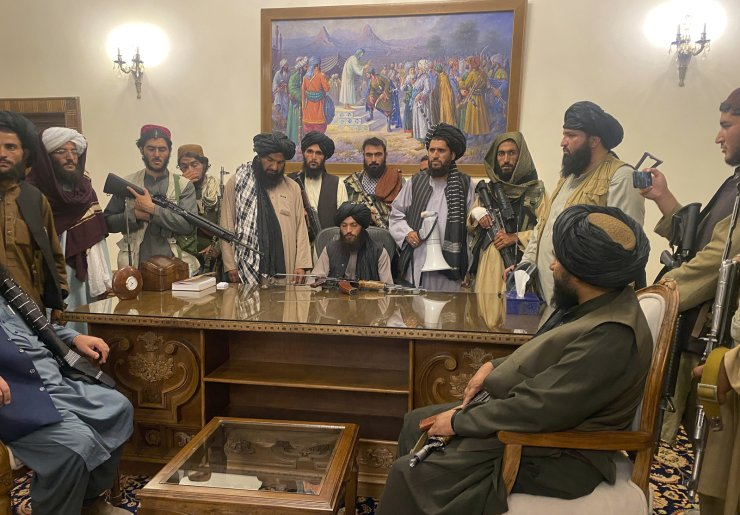 Taliban fighters take control of Afghan presidential palace after the Afghan President Ashraf Ghani fled the country, in Kabul, Afghanistan, Sunday, Aug. 15, 2021. AP