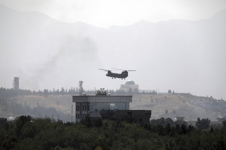 A U.S. Chinook helicopter flies over the U.S. Embassy in Kabul, Afghanistan, Sunday, Aug. 15, 2021. Helicopters are landing at the U.S. Embassy in Kabul as diplomatic vehicles leave the compound amid the Taliban advanced on the Afghan capital. AP