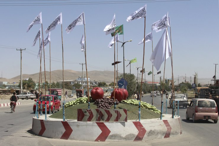 Taliban flags fly at a square in the city of Ghazni, southwest of Kabul, Afghanistan, Saturday, Aug. 14, 2021. AP