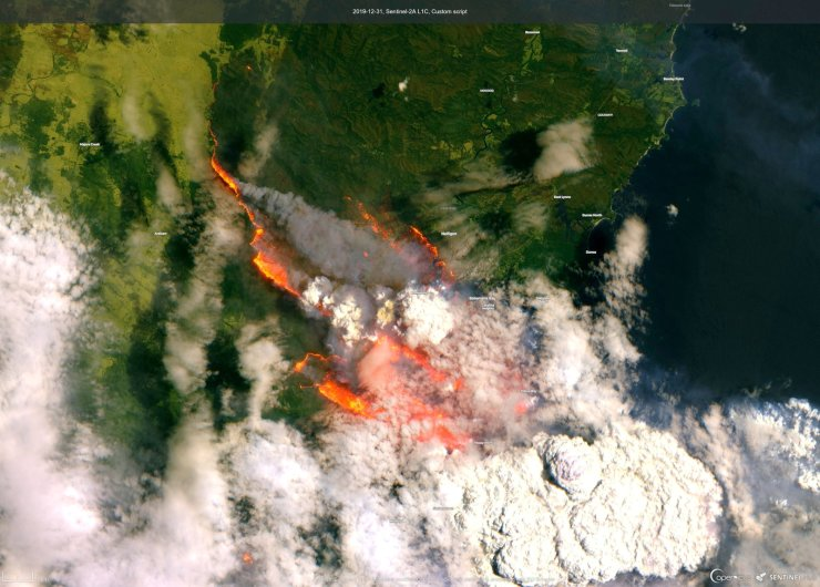A satellite image of the Batemans Bay shows smoke and fire from wild bushfires in Australia, Dec. 31, 2019. REUTERS