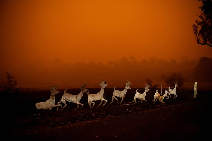 Christmas decorations are seen nearby a destroyed house in Cobargo, as bushfires continue in New South Wales, Australia Jan. 5, 2020. REUTERS
