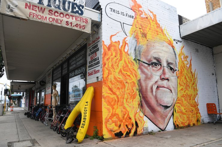A mural depicting Australian Prime Minister Scott Morrison among bushfire flames is seen in Tottenham, Melbourne, Australia, Jan. 7, 2020. Scott Morrison's handling of the Australian bushfire crisis has been widely criticized along with his government's inaction on climate change.  EPA