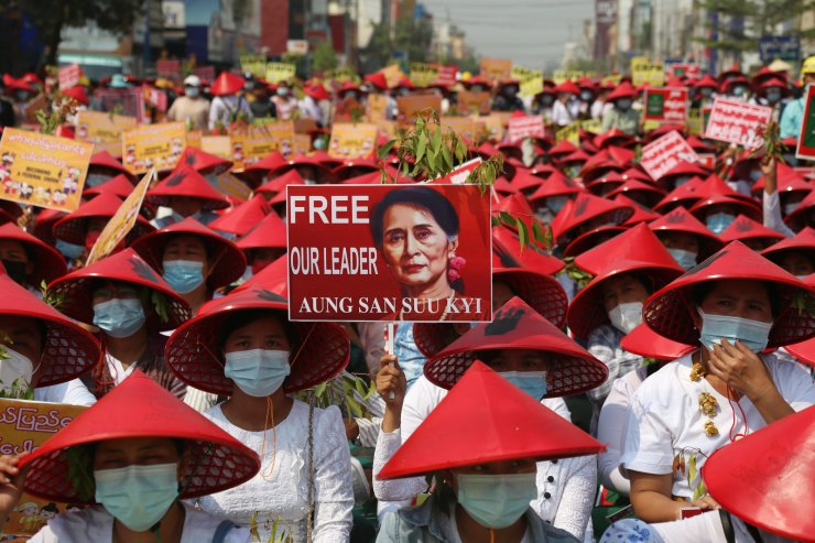 Demonstrators hold placards calling for the released of detained civilian leader Aung San Suu Kyi during a protest against the military coup in Mandalay, Myanmar, 28 February 2021. Security forces intensified their use of force to crack down on anti-coup demonstrations following weeks of unrest since the 01 February military coup. EPA