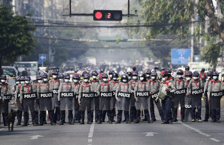 Riot police stand guard on a road during a protest against the military coup, in Yangon, Myanmar, 28 February 2021. Security forces intensified their use of force to crack down on anti-coup demonstrations following weeks of unrest since the 01 February military coup. EPA