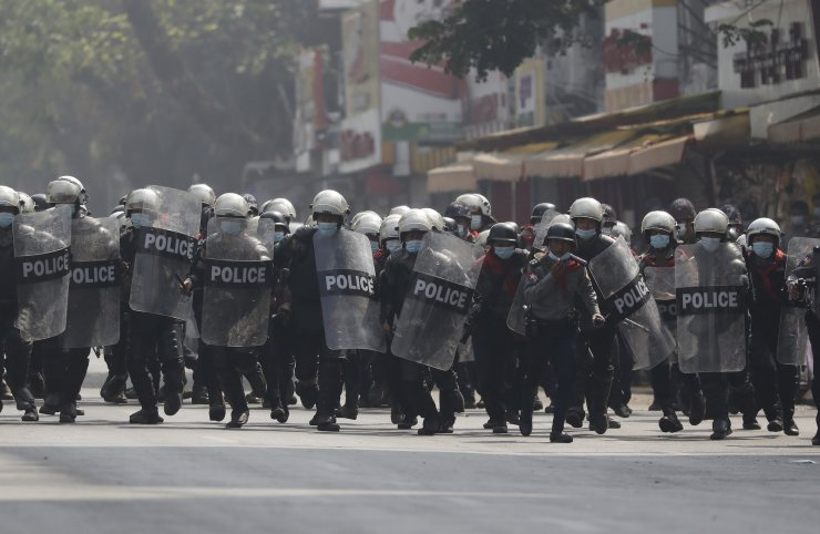 Riot police advance on demonstrators during a protest against the military coup, in Yangon, Myanmar, 27 February 2021. Anti-coup demonstrations continued despite intensifying use of force by security forces against protesters after weeks of unrest since the 01 February military coup. EPA