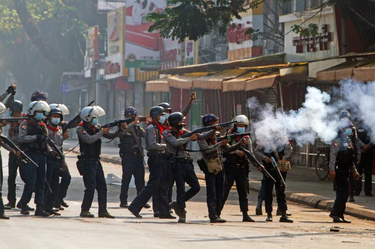 Riot police officers fire teargas canisters during a protest against the military coup in Yangon, Myanmar, February 28, 2021. REUTERS