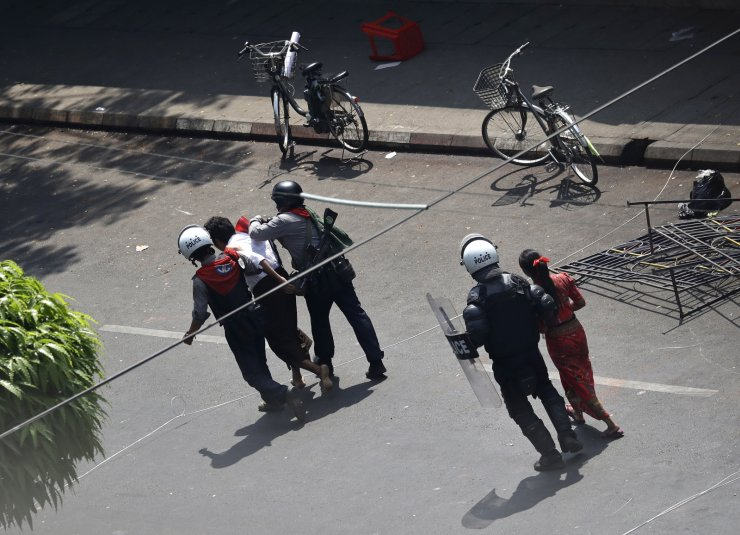 Riot police arrest demonstrators during a protest against the military coup, in Yangon, Myanmar, 27 February 2021. Anti-coup demonstrations continued despite intensifying use of force by security forces against protesters after weeks of unrest since the 01 February military coup. EPA