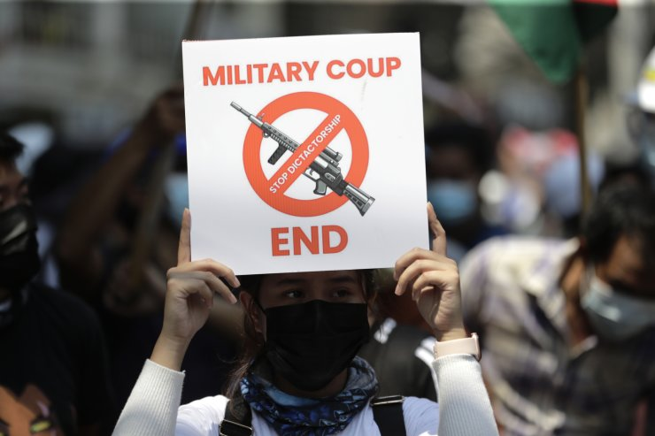 A demonstrator holds a placard during a protest against the military coup, in Yangon, Myanmar, 28 February 2021. Security forces intensified their use of force to crack down on anti-coup demonstrations following weeks of unrest since the 01 February military coup. EPA