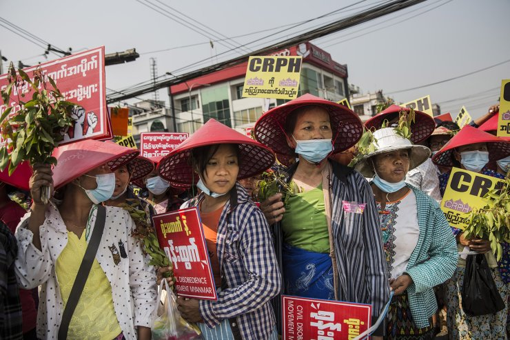 Burmese  protesters carry signs during a demonstration against the military coup in Mandalay, Myanmar, Sunday, February. 28, 2021. Security forces continue to crackdown on demonstrations against the military coup. UPI
