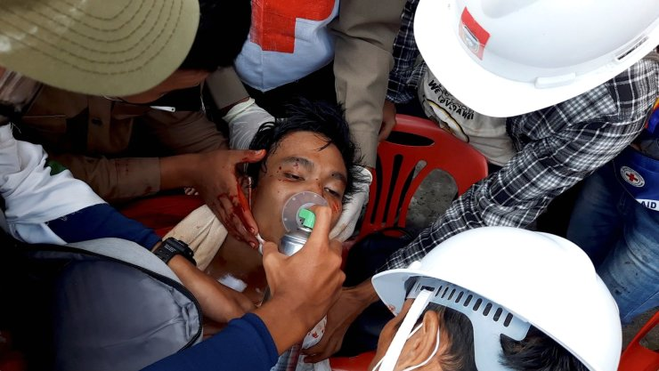 Medics attempt to treat an injured man of his gunshot wounds in Dawei, Myanmar, February 28, 2021, in this still image from video obtained via social media. DAKKHINA INSIGHT via REUTERS