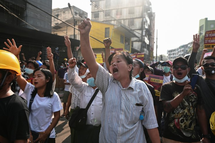 People shout slogans during a protest against the military coup in Yangon, Myanmar February 26, 2021. REUTERS