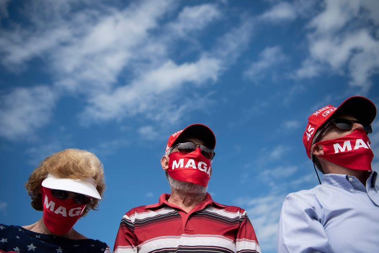 Supporters listen as US President Donald Trump speaks at a 'Make America Great Again' rally on October 15, 2020, held at Pitt-Greenville Airport in Greenville, North Carolina. AFP