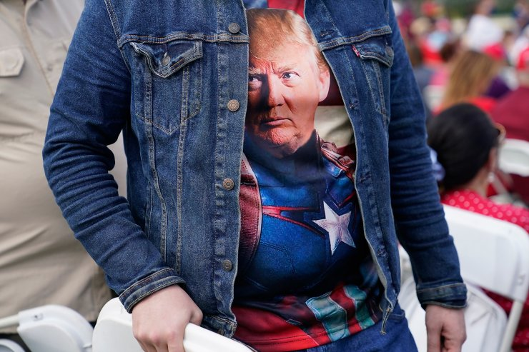 Erik Camara wears a T-shirt of President Donald Trump as he arrives for a campaign rally featuring Vice President Mike Pence at the Cuban Memorial Monument, Thursday, Oct. 15, 2020, in Miami. AP
