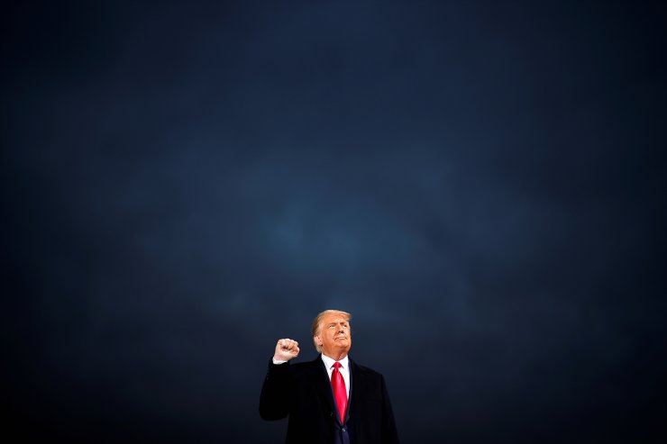 U.S. President Donald Trump makes a fist during a campaign rally at Des Moines International Airport in Des Moines, Iowa, U.S., October 14, 2020. Reuters