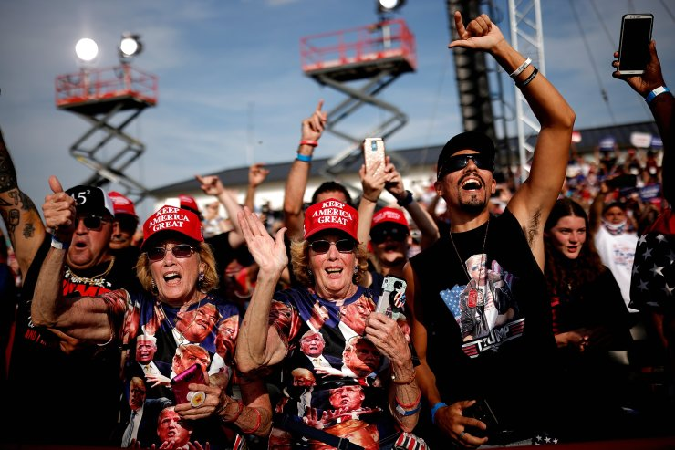 Supporters of U.S. President Donald Trump attend a campaign rally at Ocala International Airport in Ocala, Florida, U.S., October 16, 2020. Reuters