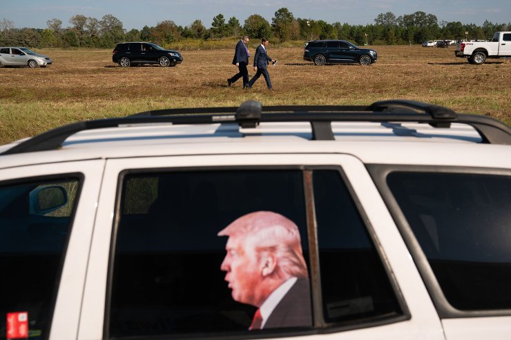 A window decal of President Donald Trump is seen in the parking lot of a campaign rally for President Donald Trump on October 16, 2020 in Macon, Georgia. AFP