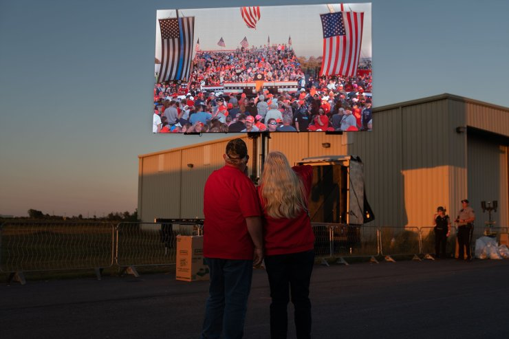 People arrive to hear President Donald Trump speak at a campaign rally on October 16, 2020 in Macon, Georgia. President Trump continues to campaign against Democratic presidential nominee Joe Biden with 18 days until election day. AFP