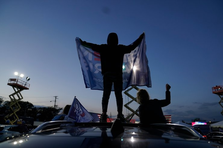 A person holds a Biden Harris flag during an event for Democratic presidential candidate former Vice President Joe Biden at Michigan State Fairgrounds in Novi, Mich., Friday, Oct. 16, 2020. AP