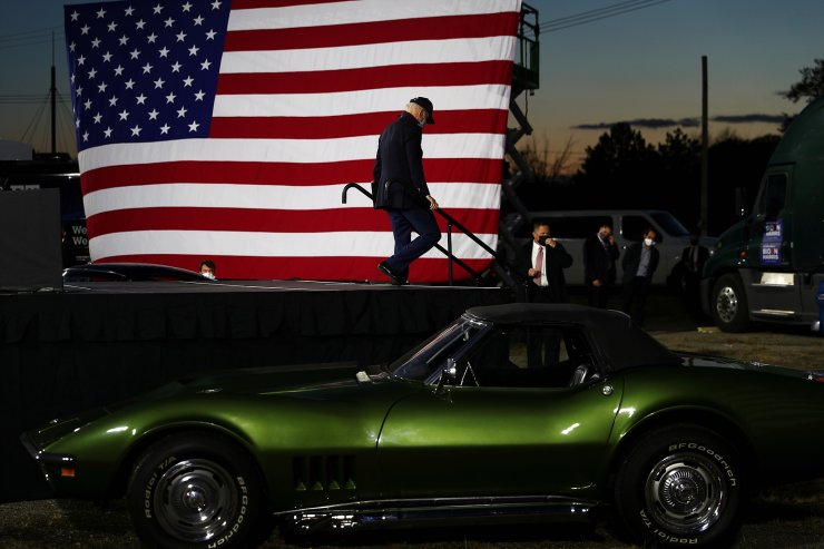 U.S. Democratic presidential candidate Joe Biden walks off the stage after delivering remarks at a voter mobilization event at the Michigan State Fairgrounds in Novi, Michigan, October 16, 2020. Reuters