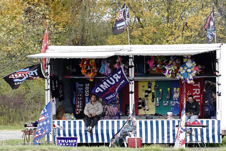 Supporters of U.S. President Donald Trump sell Trump flags and merchandise from a roadside carnival booth in Hubbard, Ohio, U.S., October 15, 2020. Picture taken October 15, 2020.Reuters