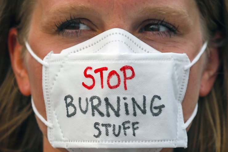 An environmental activist wears a mask with the words 'STOP BURNING STUFF' during a rally part of the international Global Climate Strike in Kuala Lumpur, Malaysia, 21 September 2019. EPA
