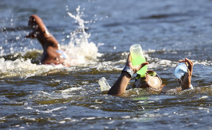 Tokyo 2020 Olympics - Open Water Swimming - Men's 10km - Final - Odaiba Marine Park - Tokyo, Japan - August 5, 2021. Tiago Campos of Portugal takes a drink during the race. REUTERS