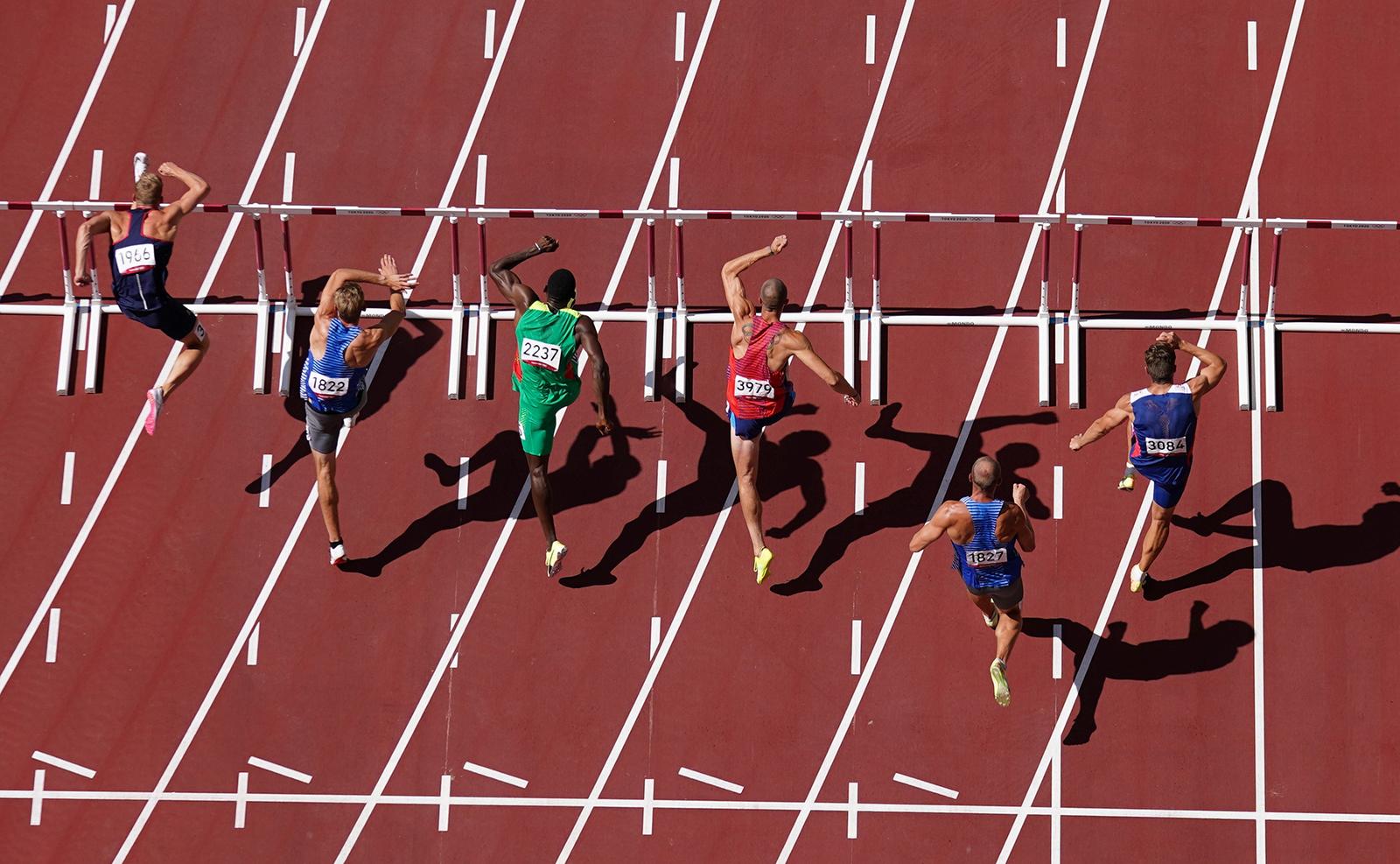 Tokyo 2020 Olympics - Athletics - Men's 110m Hurdles - Decathlon 110m Hurdles - Olympic Stadium, Tokyo, Japan - August 5, 2021. General view of athletes in action during Heat 1. REUTERS