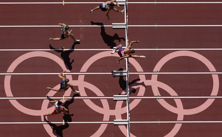 Adam Helcelet, of Czech Republic, wins his heat in the men's decathlon 110-meter hurdles at the 2020 Summer Olympics, Thursday, Aug. 5, 2021, in Tokyo. AP