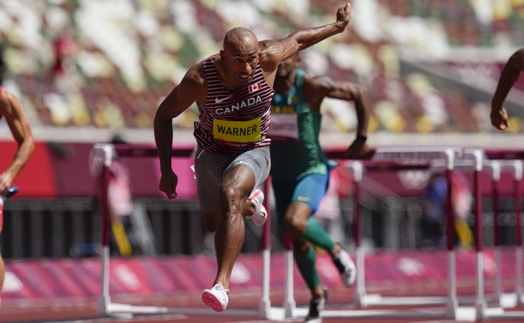Damian Warner, of Canada, wins a heat in the men's decathlon 110-meter hurdles at the 2020 Summer Olympics, Thursday, Aug. 5, 2021, in Tokyo, Japan. AP
