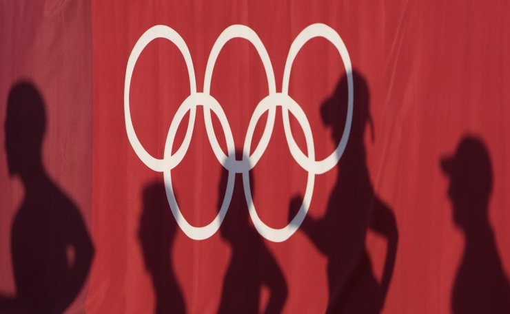 Athlete's shadows appear on a curtain during the men's 50km race walk at the 2020 Summer Olympics, Friday, Aug. 6, 2021, in Sapporo, Japan. AP