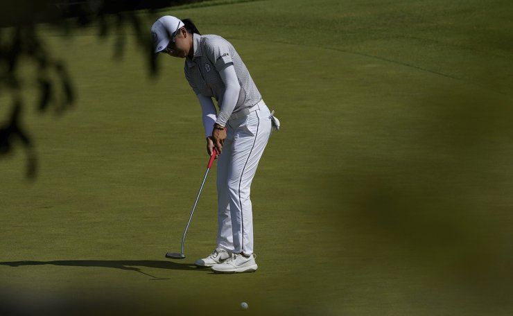 Wei-Ling Hsu, of Taiwan, makes a putt on the second hole during the third round of the women's golf event at the 2020 Summer Olympics, Friday, Aug. 6, 2021, at the Kasumigaseki Country Club in Kawagoe, Japan. AP