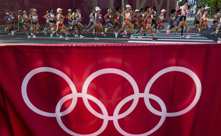 Runners compete in the women's marathon at the 2020 Summer Olympics, Saturday, Aug. 7, 2021, in Sapporo, Japan. AP