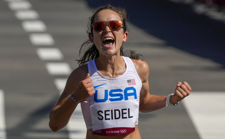 Molly Seidel, of the United States, celebrates as she crosses the finish line to win the bronze medal in the women's marathon at the 2020 Summer Olympics, Saturday, Aug. 7, 2021, in Sapporo, Japan. AP