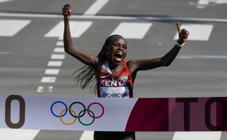 Peres Jepchirchir, of Kenya, celebrates as she crosses the finish line to win the women's marathon at the 2020 Summer Olympics, Saturday, Aug. 7, 2021, in Sapporo, Japan. AP