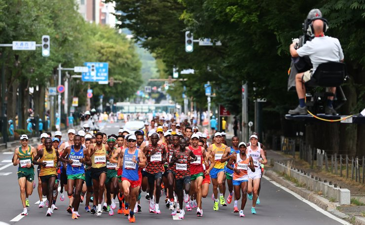 Tokyo 2020 Olympics - Athletics - Men's Marathon - Sapporo Odori Park, Sapporo, Japan - August 8, 2021. General view of the athletes in action with Jeison Alexander Suarez of Colombia leading. REUTERS