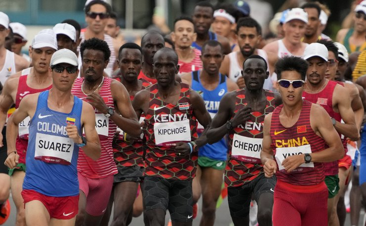 Runners compete during the men's marathon at the 2020 Summer Olympics, Sunday, Aug. 8, 2021, in Sapporo, Japan. AP