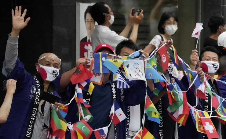 Fans watch during the men's marathon at the 2020 Summer Olympics, Sunday, Aug. 8, 2021, in Sapporo, Japan. AP