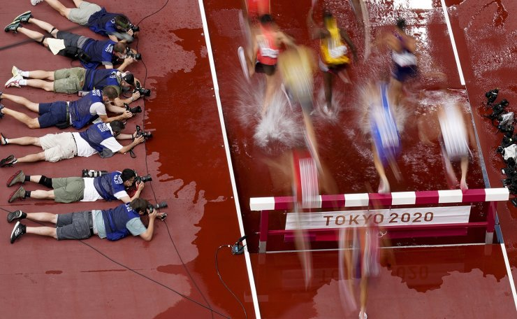 Photojournalists at the 2020 Summer Olympics, Friday, July 30, 2021, in Tokyo. AP